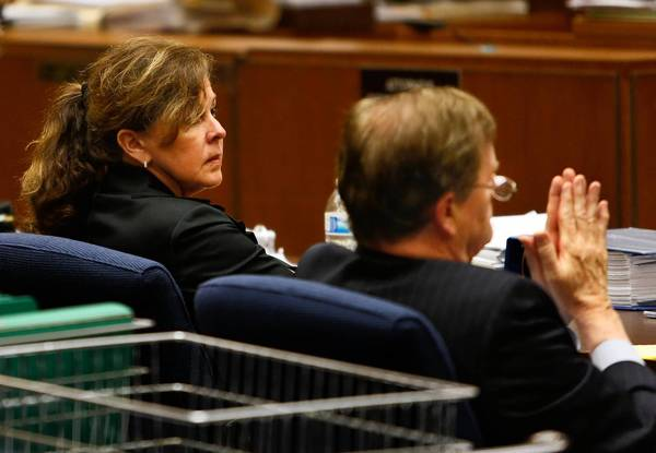 Angela Spaccia, former assistant city manager of Bell, and attorney Harland Braun listen to the prosecution's closing argument.