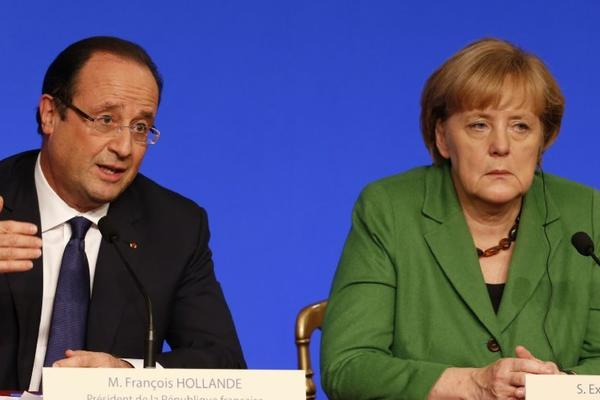 French president Franois Hollande, left, and German Chancellor Angela Merkel hold a press conference during a European Union leaders conference to discuss ways of tackling youth unemployment at the Elysee palace in Paris.