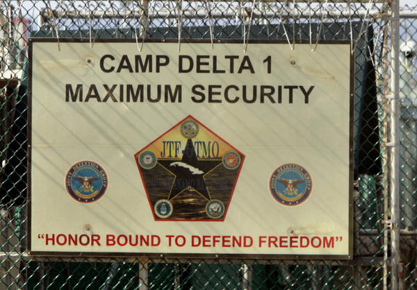 U.S. military guards walk within Camp Delta military-run prison at the Guantanamo Bay U.S. Naval Base, Cuba.