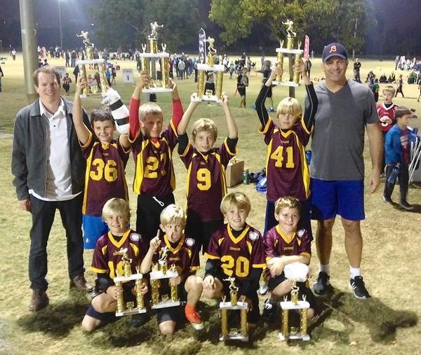 The Minnesota Golden Gophers (11-2) won the third- and fourth-grade division title in the Newport Mesa Friday Night Lights flag football league, beating out 33 other teams to gain the top spot. The team is, bottom row, from left: Cole McKibbin, Kevin Forbath, Michael Gurka and Braeden Kassouf. Top row, from left: Coach Brian Forbath, Ben Ciano, Luke O'Neil, Brandon Kincaid, James Allemann and Coach Jon Gurka.