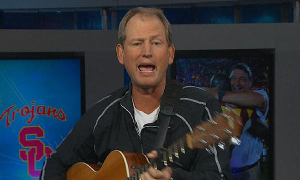 Former UCLA coach Rick Neuheisel shows off his singing and playing skills.