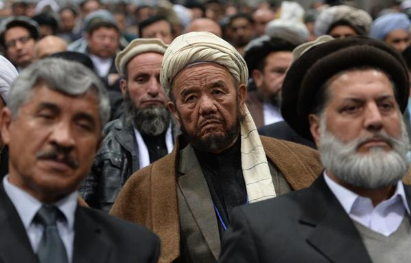 Members of the Afghan loya jirga, a meeting of about 2,500 Afghan tribal elders and leaders, listen Thursday during the first day of a four-day gathering in Kabul.
