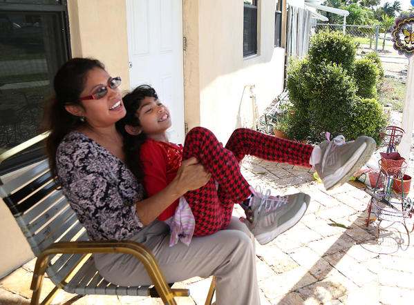 Aleida Morales Escobar, of Pompano Beach, with her daughter Isavella,8.