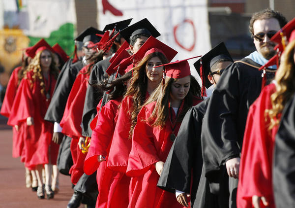 A line of graduates enter graduation ceremonies for Glendale High School on Tuesday, June 4, 2013.