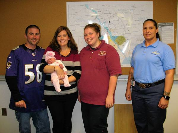 Matt and Emily Kulaga with new daughter, Aubree Mae, meet the Harford County 911 dispatchers, Christina Abrams, second from right, and Amanda Dolehanty, right, who helped the couple deliver their baby over the phone.