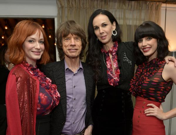 Actress Christina Hendricks, left, singer Mick Jagger, fashion designer L'Wren Scott and actress Jessica Pare attend the launch celebration of the Banana Republic L'Wren Scott Collection.