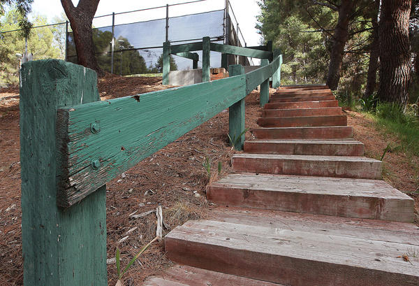 The wooden steps and rail that lead to the tennis courts at Brace Canyon Park are part of the millions dollars worth of infrastructure needs at city parks and facilities in Burbank. Photographed on Tuesday, Nov. 19, 2013.