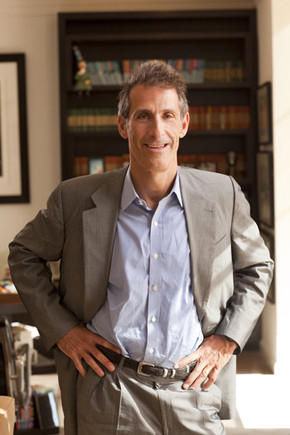 Sony Entertainment Inc. Chief Executive Michael Lynton, who is also chairman and CEO of Sony Pictures Entertainment, addressed cost-cutting at an investor meeting Thursday. Above, Lynton in his office in 2010.