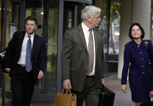 Harold McIlhenny, center, an attorney who represents Apple in the Apple-Samsung trial, exits a federal courthouse in San Jose.