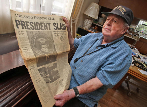 Bill Summers, 86, of Orlando, a former news editor at the Orlando Sentinel, holds the front page 'Orlando Evening Star', an afternoon edition that he redesigned after hearing that President John F. Kennedy had been shot and killed.