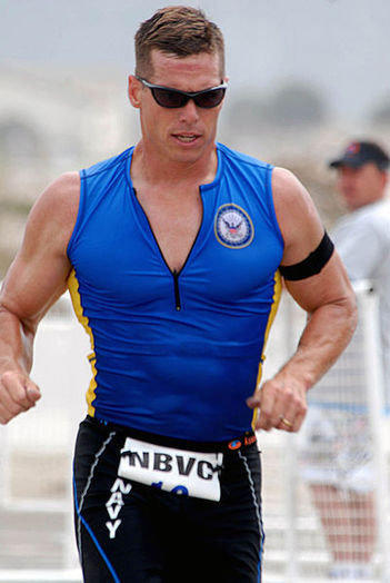 Navy Capt. David Haas during a triathlon competition at the base in Ventura County. He is the third officer to be suspended during a bribery investigation; two others have been charged.