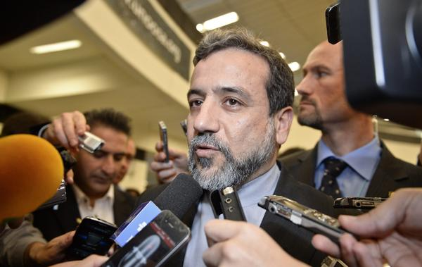 Iranian Deputy Foreign Minister Abbas Araqchi, shown talking with journalists last month after a meeting with the International Atomic Energy Agency, said Thursday in Geneva that Iran demands easing of oil and banking sanctions.