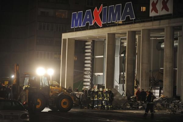 Rescuers search for survivors at the Maxima XX supermarket in Riga, Latvia, after a roof collapsed.