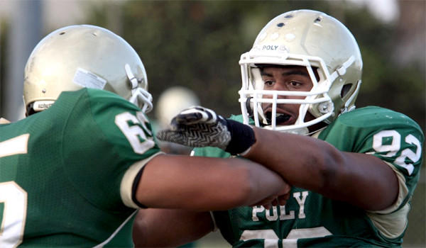 Joseph Wicker takes part in a drill during a Long Beach Poly practice on Sept. 25. Poly faces St. Bonaventure in a Pac-5 Division quarterfinal game Friday.
