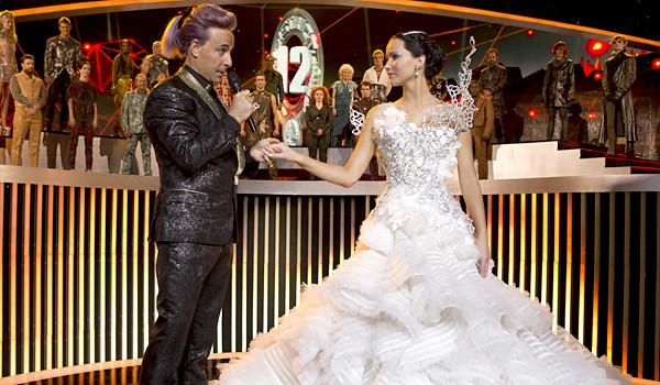 "Caesar Flickerman (Stanley Tucci) and Katniss Everdeen (Jennifer Lawrence) in ""The Hunger Games: Catching Fire."""
