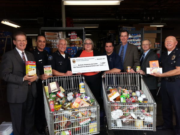 The Burbank police union and command staff donated $1,500 to the Burbank Temporary Aid Center in November 2013 to help fund the agencys efforts to distribute holiday dinner supplies to hundreds of Burbank households.