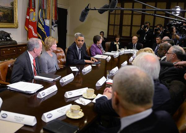 President Obama meets with health insurance executives at the White House. They discussed a proposal that would allow insurers to extend health plans that are being canceled because they fail to meet the Affordable Care Act's standards.