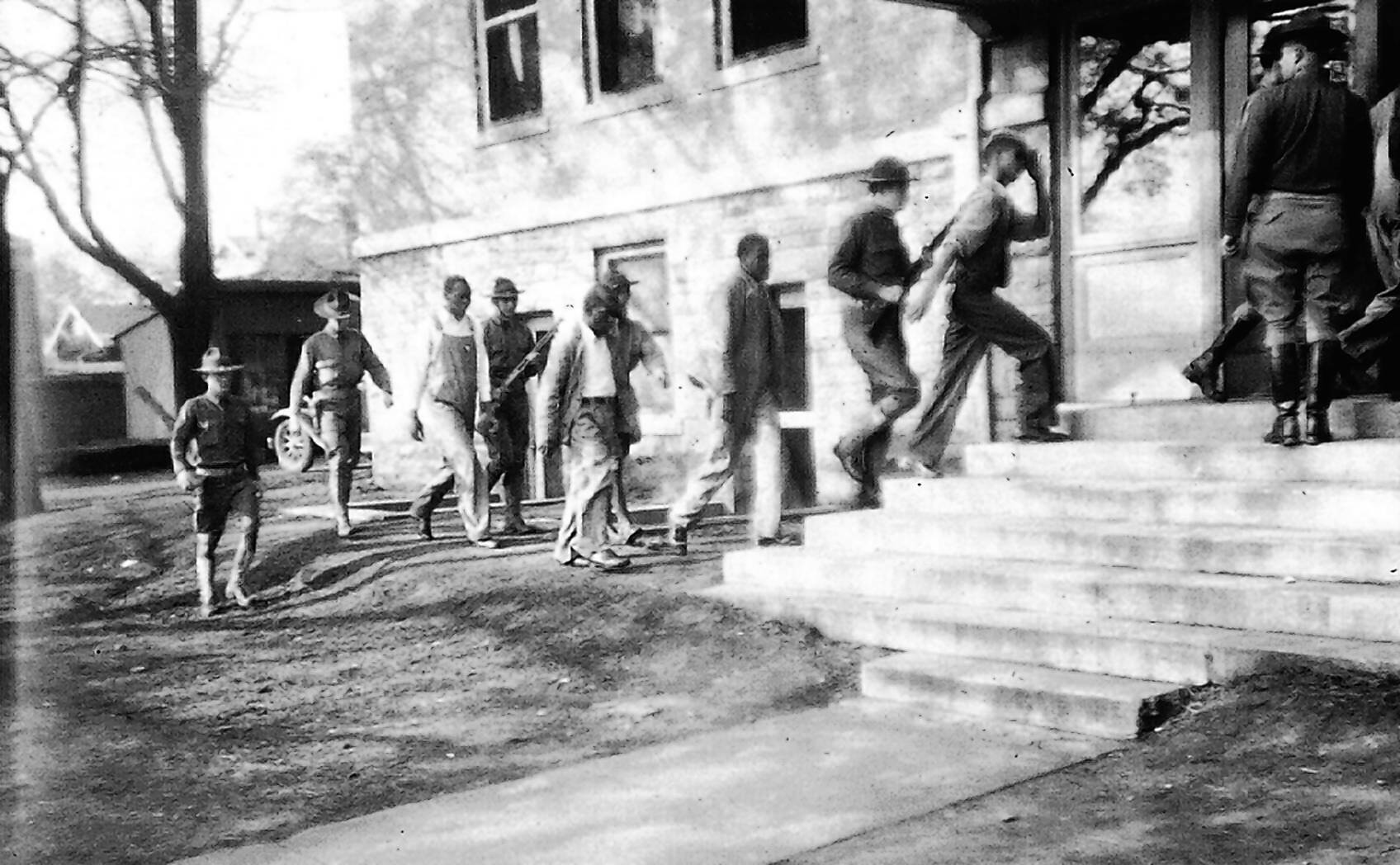 Members of the Alabama National Guard escort the Scottsboro Boys - a group of black teenagers falsely accused of rape - into court in 1933. The state's parole board Thursday granted pardon posthumously to the last of the teens.
