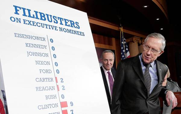 Senate Majority Leader Harry Reid (D-Nev.) uses a chart to explain the decision by Democrats to change a Senate rule that allowed Republicans to block many of President Obama's appointments.