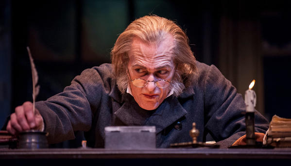"Larry Yando as Scrooge in Goodman Theatre's production of Charles Dickens' ""A Christmas Carol"""