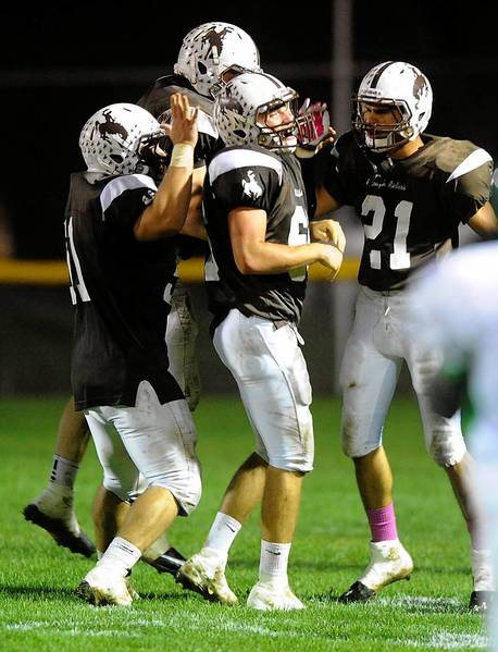 Catasauqua's Tyler Trobetsky (center) celebrates his interception with his teammates during their Colonial League football game with Pen Argyl on October 11, 2013.