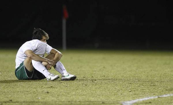 William & Mary's Michael Teiman sits on the field after the Tribe lost 4-2 in penalty kicks to opponent George Mason during Thursday's first round NCAA tournament game in Williamsburg.