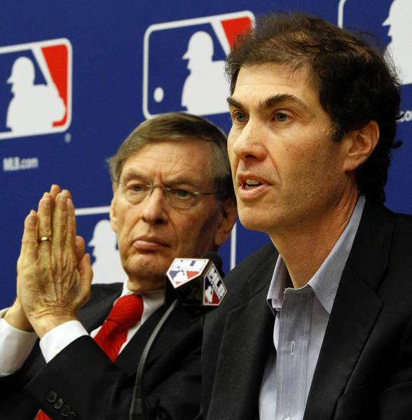 In this 2011 photo, Michael Weiner, right, head of the Major League Baseball Players Assn., appears with Commissioner Bud Selig at a news conference announcing a five-year collective bargaining agreement. Weiner, 51, died of cancer Thursday.