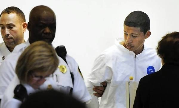 Philip Chism, 14, stands during his arraignment for the death of Danvers High School teacher Colleen Ritzer in Salem District Court in Boston