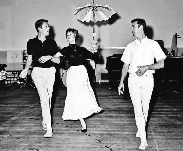 "Choreographer and dancer Marc Breaux, right, works with Dick Van Dyke and Julie Andrews in a dance scene for ""Mary Poppins"" in 1963."