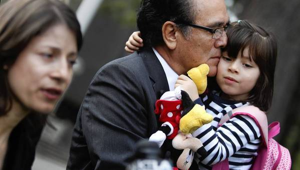 Norma Patricia Esparza, left, speaks during a news conference while her husband, Jorge Mancillas, holds their 4-year-old daughter, Arianna Mancillas, outside the Central Justice Center in Santa Ana on Wednesday.