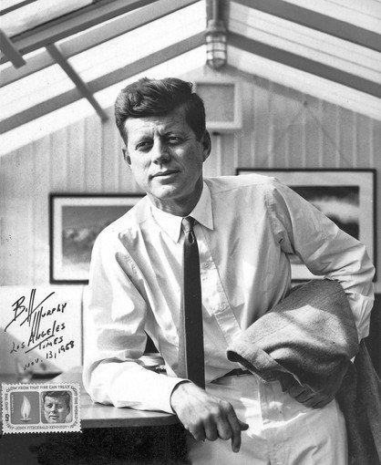 This portrait of then-Sen. John F. Kennedy was taken in 1958 at the home of Kennedy's brother-in-law Peter Lawford in Santa Monica. The photo was used in 1964 in the first stamp commemorating Kennedy after his assassination. William S. Murphy, who took the photo, autographed the print and placed one of the stamps in the lower left corner.