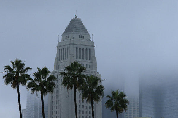 City Hall is the only building visible on the Los Angeles skyline as storm clouds obscure the other office towers Thursday.