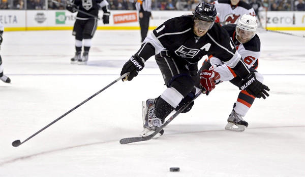 Kings center Anze Kopitar and New Jersey defenseman Andy Green vie for a loose puck during the Devils' 2-1 overtime win in L.A.