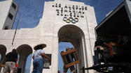 Former accounting firm settles claims over Coliseum audits