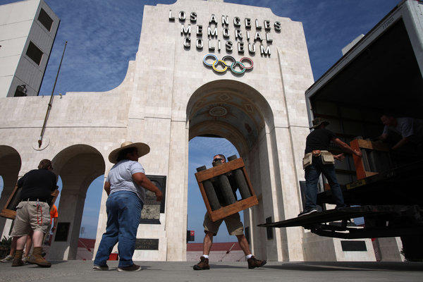Workers started set up fireworks at the Los Angeles Memorial Coliseum