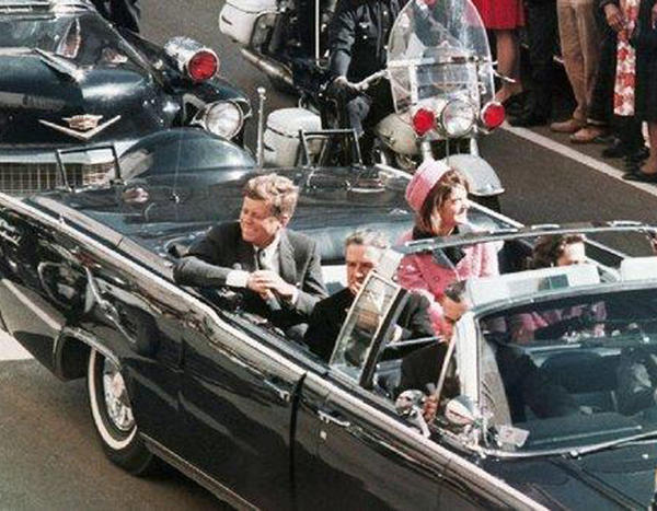 President John F. Kennedy's motorcade travels through Dallas on Nov. 22, 1963.