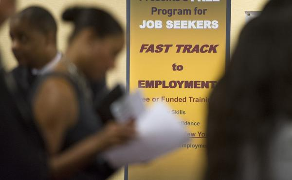 The number of job openings in September reached 3.9 million, a five-year high. Above, job seekers talk to recruiters at an Atlanta job fair earlier this year.