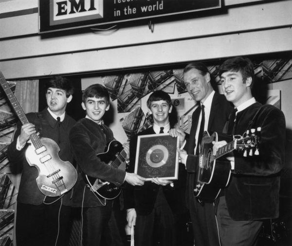 "The Beatles, shown on April 8, 1963, with producer George Martin, were introduced to a national television audience in the U.S. by ""CBS Morning News"" anchor Mike Wallace on Nov. 22, 1963, hours before President John F. Kennedy was assassinated in Dallas."