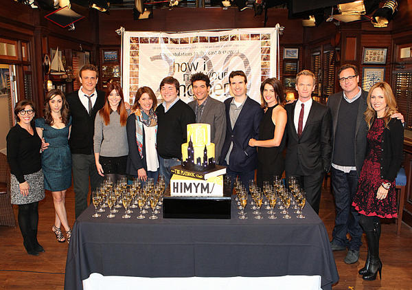 "CBS President of Entertainment Nina Tassler, far left, joins the cast, producers and crew of ""How I Met Your Mother"" as the series marked its 200th episode Thursday in Los Angeles."