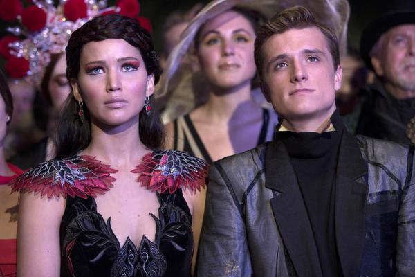 """Jennifer Lawrence as Katniss Everdeen and Josh Hutcherson as Peeta Mellark in """"Hunger Games: Catching Fire."""""""