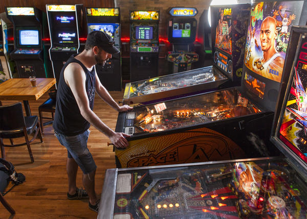 Challenge others at the pinball machines at Emporium on Tuesday.