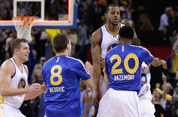Golden State forward Andre Iguodala is lifted into the air by a teammate after hitting the game-winning shot against the Thunder as time expired Thursday night.