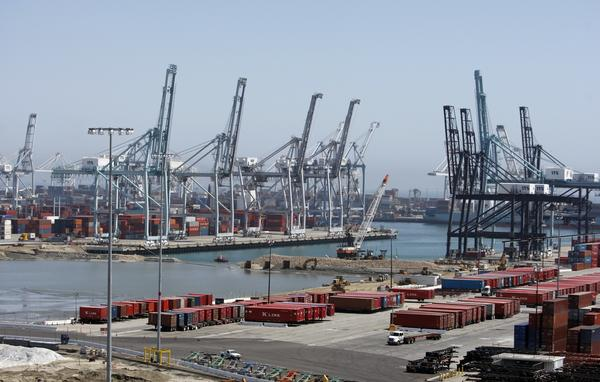 A Caterpillar subsidiary is being investigated by federal authorities who are looking into whether the rail repair firm illegally dumped train parts in the ocean near the Port of Long Beach, pictured above in 2011.
