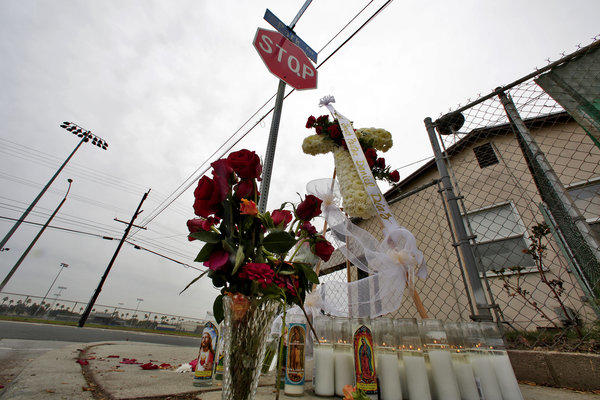 A makeshift memorial for youth pastor Daniel Diaz was erected at the intersection in Pomona where he was shot and killed.