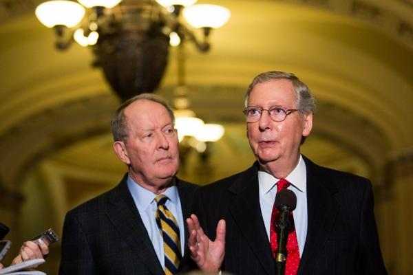 Sen. Lamar Alexander (R-Tenn.) looks on as Senate Minority Leader Mitch McConnell (R-Ky.) speaks after the Senate voted 52-48 to invoke the so-called nuclear option, voting to change Senate rules on the controversial filibuster for most presidential nominations with a simple majority vote. McConnell warned that the Democrats would face consequences.