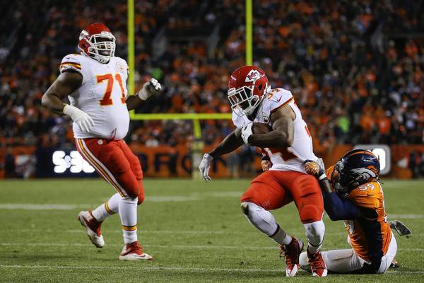 DENVER, CO - NOVEMBER 17: Knile Davis #34 of the Kansas City Chiefs is tackled by Danny Trevathan #59 of the Denver Broncos in the second quarter at Sports Authority Field at Mile High on November 17, 2013 in Denver, Colorado. (Photo by Justin Edmonds/Getty Images) ORG XMIT: 184890805 ** OUTS - ELSENT, FPG, TCN - OUTS * NM, PH, VA if sourced by CT, LA or MoD **