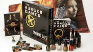 Ad campaign (lip) glosses over 'Hunger Games' message