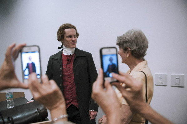 Steven Edenbo of Philadelphia (left) gets mobbed as he gets ready to present as Thomas Jefferson with Betty Grinnan of Boca Raton (right).