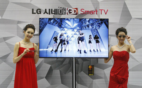 South Korean models pose with an LG Cinema 3D Smart TV. LG has confirmed that its Smart TVs have been gathering information on users' viewing habits even after users opt out.
