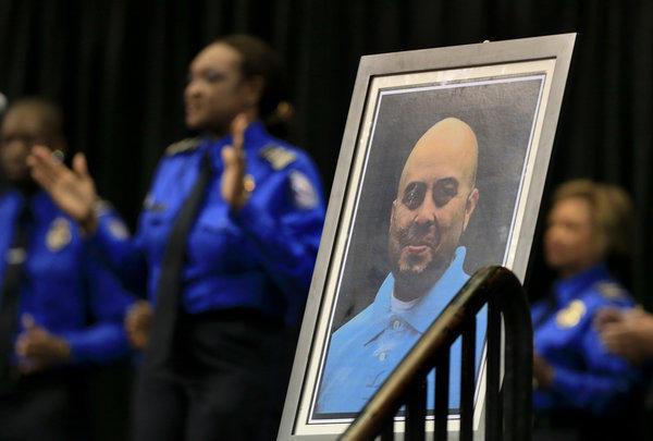 The TSA chorus sings at a memorial for slain Transportation Security Administration Officer Gerardo I. Hernandez.